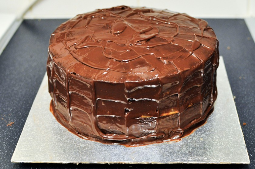 Cake covered in melted chocolate