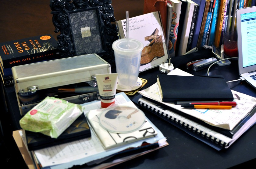 Detail of desk with different objects on it