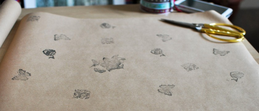 Stamping brown paper for presents