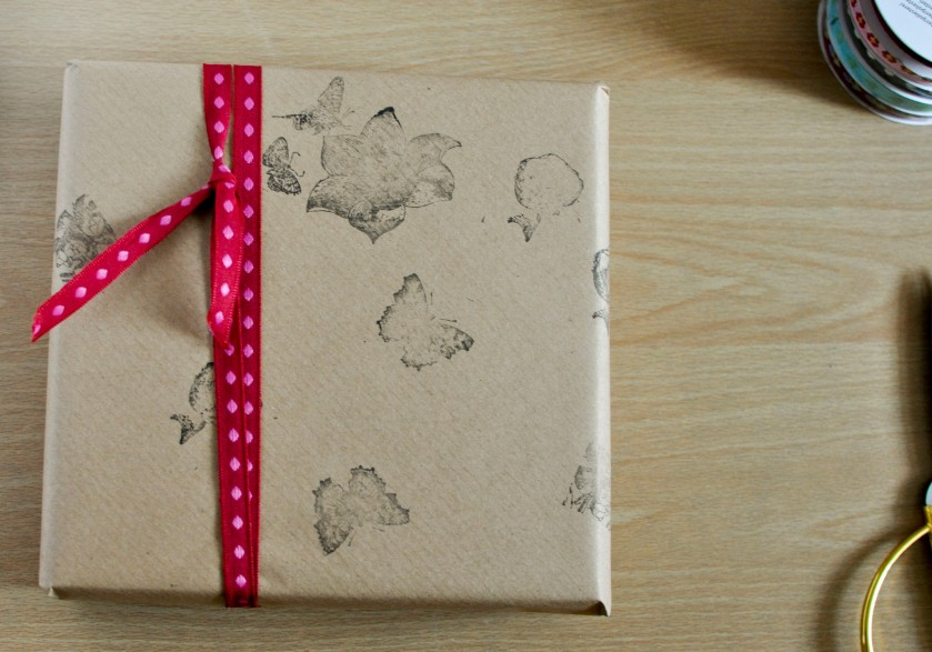 Small butterfly stamped present with red bow