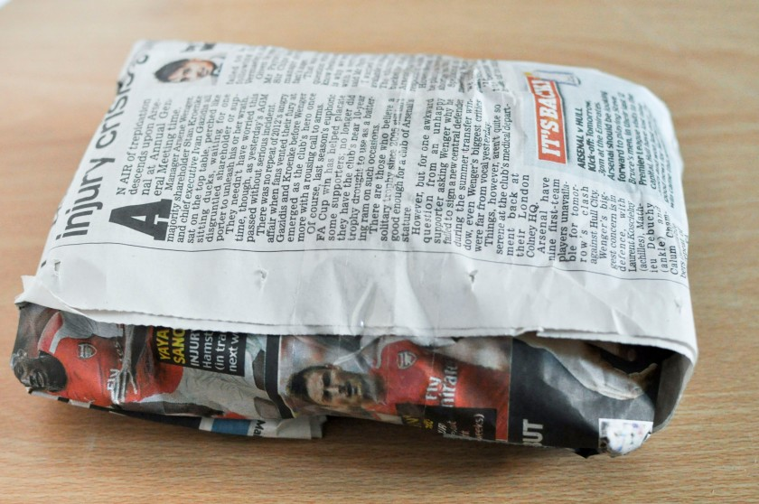 Decoy gift wrapped in newspaper